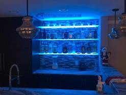 LED Floating Shelves Against Tile Backsplash